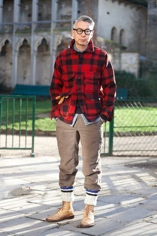 Brown Chinos Outfits: This combination of a red and black check flannel shirt jacket and brown chinos is put together and yet it looks laid-back and apt for anything. Make this outfit a bit more polished by finishing with a pair of tan leather brogue boots.