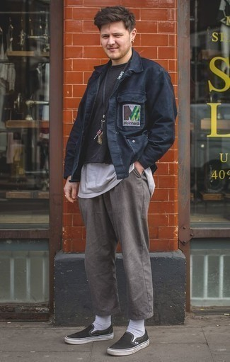 How to Wear a Navy Shirt Jacket For Men: A navy shirt jacket and grey chinos are the kind of a foolproof getup that you so desperately need when you have no extra time. Introduce black canvas slip-on sneakers to the mix to infuse a dash of stylish effortlessness into this getup.