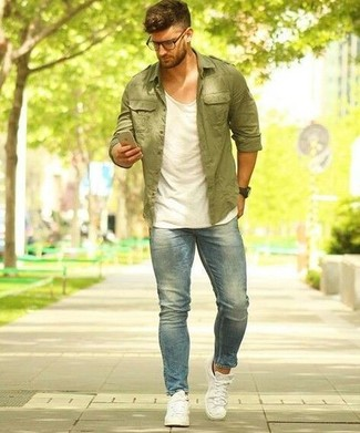 How to wear: olive shirt jacket, white tank, light blue jeans, white canvas low top sneakers
