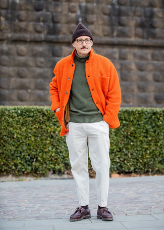 Burgundy Leather Desert Boots Outfits: This combo of an orange shirt jacket and white corduroy dress pants is seriously dapper and creates instant appeal. Let your styling skills truly shine by complementing your look with burgundy leather desert boots.