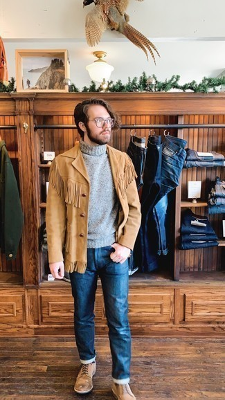 Men's Outfits 2020: Pair a tan shirt jacket with blue jeans to put together an incredibly stylish and modern-looking casual ensemble. For extra fashion points, choose a pair of tan suede casual boots.
