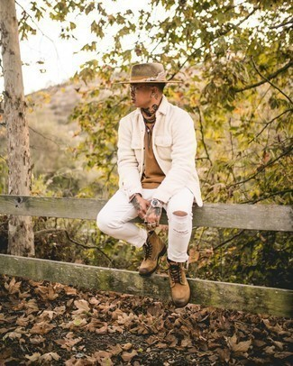 Tan Turtleneck Outfits For Men: Wear a tan turtleneck with white ripped jeans for a kick-ass and fashionable ensemble. To introduce some extra flair to this look, add tan suede casual boots to the equation.