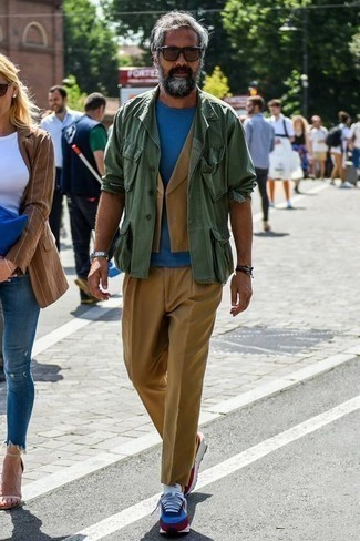 How to Wear a Shirt Jacket For Men: Such essentials as a shirt jacket and khaki chinos are an easy way to infuse extra refinement into your daily casual arsenal. Does this outfit feel too fancy? Let a pair of white and red and navy athletic shoes change things up a bit.