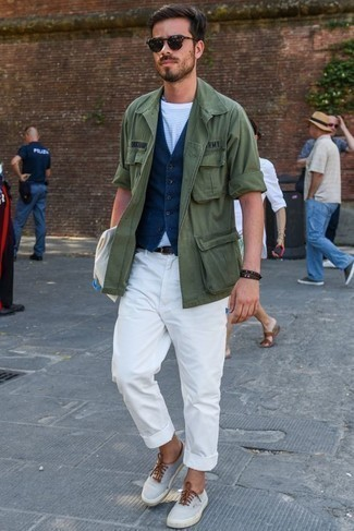 Navy Waistcoat Outfits: This combination of a navy waistcoat and white chinos will add classy essence to your outfit. Finishing off with grey canvas low top sneakers is a surefire way to inject an element of stylish casualness into this look.