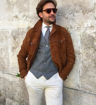 How to wear: tobacco suede shirt jacket, grey waistcoat, white dress shirt, beige chinos