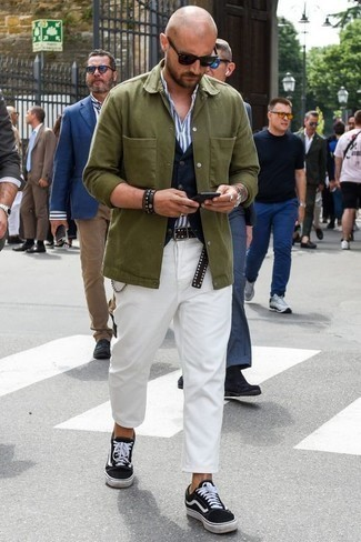 How to Wear an Olive Shirt Jacket For Men: An olive shirt jacket and white chinos are the kind of smart items that you can wear a hundred of ways. Give a laid-back touch to your ensemble by finishing with a pair of black and white canvas low top sneakers.