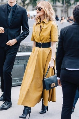 How to wear: mustard shirtdress, black leather ankle boots, black leather clutch, black leather waist belt