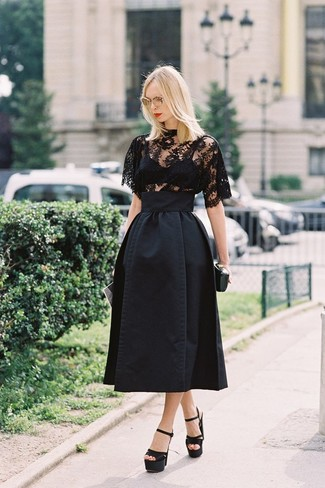Pairing a black lace short sleeve blouse with a black full skirt is a comfortable option for running errands in the city. Elevate this ensemble with black satin heeled sandals.