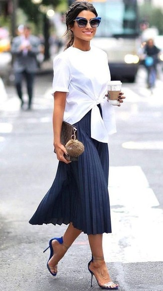 This pairing of a white short sleeve blouse and a navy pleated midi skirt is super easy to create and so comfortable to wear all day long as well! A pair of blue suede heeled sandals will add more polish to your overall look.  So if you're in search of an insta-worthy outfit on a warm summer day, you found it.