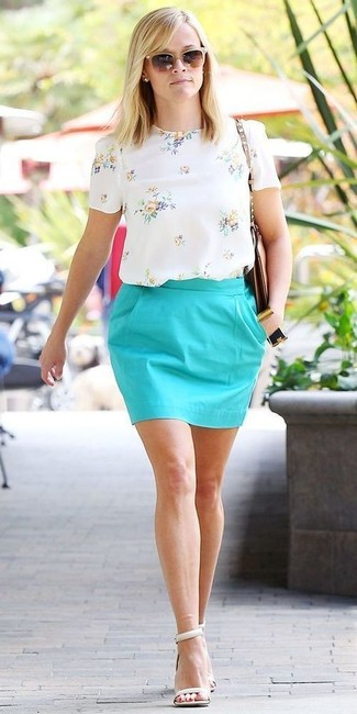 Reese Witherspoon wearing White Floral Short Sleeve Blouse, Aquamarine Mini Skirt, White Leather Heeled Sandals, Brown Leather Crossbody Bag