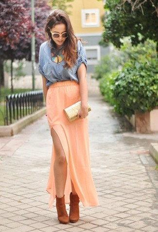 How to wear: blue denim short sleeve button down shirt, orange maxi skirt, orange suede ankle boots, gold sequin clutch