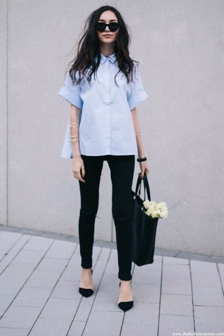How to wear: light blue short sleeve button down shirt, black ripped skinny jeans, black suede pumps, black leather tote bag