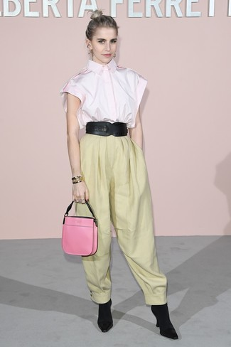 How to wear: pink short sleeve button down shirt, yellow wide leg pants, black elastic ankle boots, hot pink leather handbag