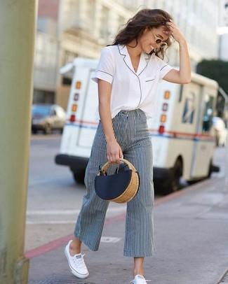 How to Wear White Canvas Low Top Sneakers For Women: A white short sleeve button down shirt and navy and white vertical striped wide leg pants are among those sport-anywhere-anytime items that have become the absolute mainstays of our wardrobes. Add white canvas low top sneakers to this ensemble to easily ramp up the wow factor of this outfit.