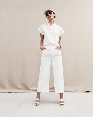 How to wear: white short sleeve button down shirt, white denim wide leg pants, white leather mules, beige cap