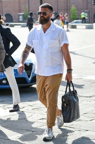 How to Wear Khaki Chinos: For relaxed dressing with a contemporary spin, make a white short sleeve shirt and khaki chinos your outfit choice. A cool pair of white athletic shoes is a simple way to infuse an air of stylish casualness into your getup.