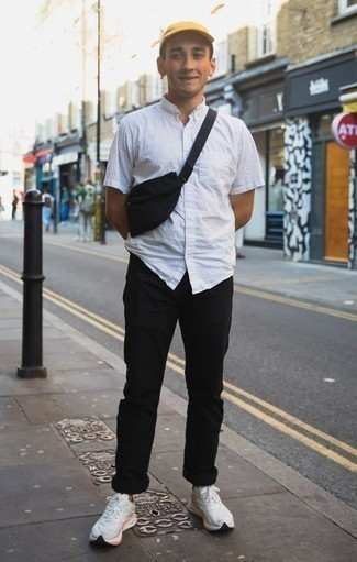 How to Wear a White Short Sleeve Shirt For Men: Try pairing a white short sleeve shirt with black chinos to demonstrate you've got expert sartorial prowess. Puzzled as to how to round off? Complement your look with white athletic shoes to switch things up.
