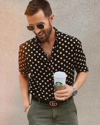 How to wear: black polka dot short sleeve shirt, olive chinos, black leather belt, black sunglasses
