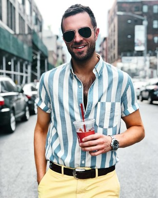 How to wear: white and blue vertical striped short sleeve shirt, yellow chinos, black leather belt, black sunglasses