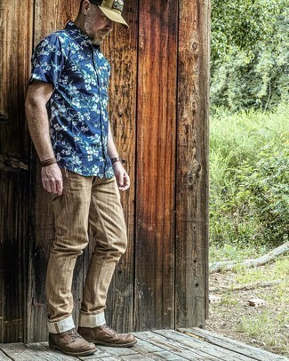 Brown Chinos Outfits: Opt for a navy floral short sleeve shirt and brown chinos if you seek to look neat and relaxed without trying too hard. Introduce a pair of dark brown leather casual boots to the equation to easily step up the classy factor of your outfit.