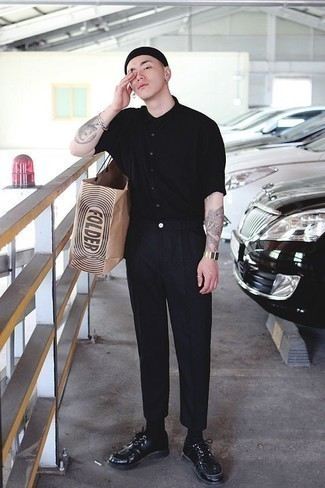 How to Wear Black Studded Leather Derby Shoes: A black short sleeve shirt and black chinos are the ideal way to introduce some cool into your current casual arsenal. Let your outfit coordination skills really shine by finishing off your ensemble with a pair of black studded leather derby shoes.