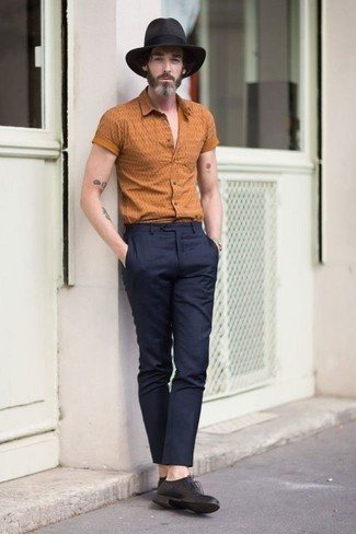 Orange Print Short Sleeve Shirt Outfits For Men: An orange print short sleeve shirt and navy chinos are both versatile menswear must-haves that will integrate brilliantly within your daily off-duty collection. Infuse this outfit with a bit of polish by finishing with black leather derby shoes.