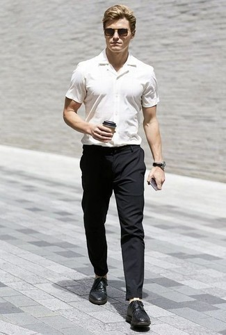 How to Wear a White Short Sleeve Shirt For Men: Uber dapper and practical, this off-duty combo of a white short sleeve shirt and black chinos provides with variety. Break up this look by slipping into black woven leather derby shoes.