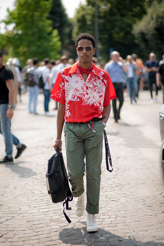 How to wear: red floral short sleeve shirt, olive chinos, white high top sneakers, black and white leather backpack