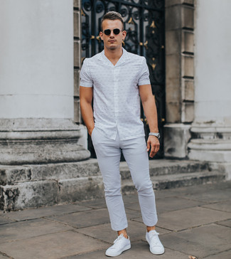 How to wear: white print short sleeve shirt, grey chinos, white low top sneakers, black sunglasses