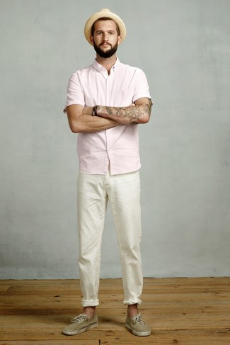 How to wear: pink short sleeve shirt, white chinos, olive canvas low top sneakers, tan straw hat