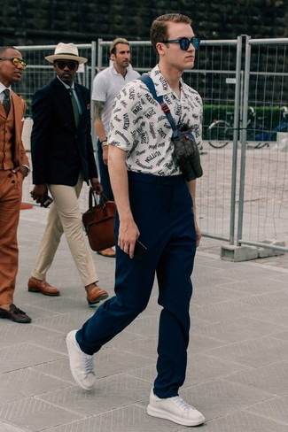 How to wear: white and navy print short sleeve shirt, navy chinos, white leather low top sneakers, black leather fanny pack