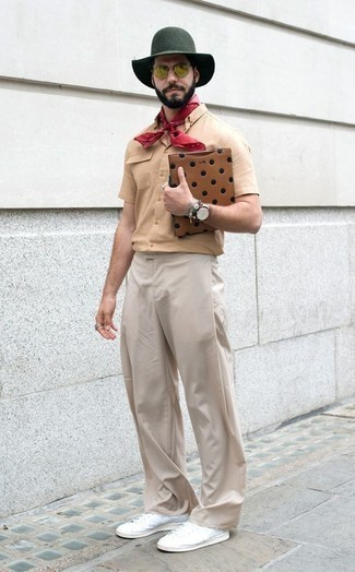How to Wear White Canvas Low Top Sneakers For Men: Pair a tan short sleeve shirt with beige chinos for relaxed dressing with a fashionable spin. White canvas low top sneakers are a stylish companion for this outfit.