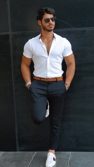 How to Wear a Tobacco Leather Belt For Men: If you're a fan of stay-in clothing that's stylish enough to wear out, consider this pairing of a white short sleeve shirt and a tobacco leather belt. Puzzled as to how to finish this outfit? Finish with white print leather low top sneakers to smarten it up.