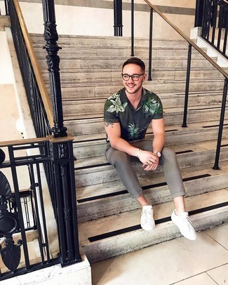 500+ Summer Outfits For Men: Why not try teaming a dark green print short sleeve shirt with grey chinos? These items are super practical and look amazing paired together. When not sure as to the footwear, stick to white canvas low top sneakers. What an excellent choice for summertime!