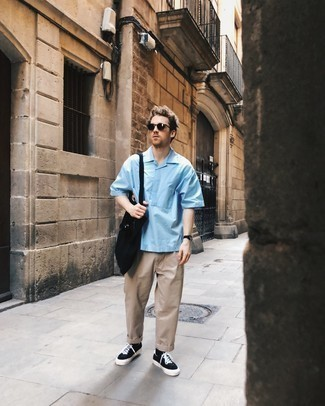 Light Blue Short Sleeve Shirt Outfits For Men: This pairing of a light blue short sleeve shirt and beige chinos is the perfect foundation for a great number of stylish ensembles. The whole outfit comes together if you add black and white canvas low top sneakers to the mix.