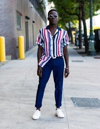 Navy Canvas Belt Outfits For Men: Why not rock a white and red and navy vertical striped short sleeve shirt with a navy canvas belt? As well as very functional, these pieces look awesome paired together. Tap into some Idris Elba stylishness and introduce white canvas low top sneakers to your ensemble.