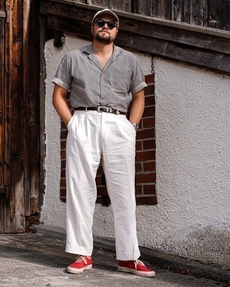 Men's Outfits 2021: Consider teaming a grey short sleeve shirt with white chinos for a casual kind of refinement. The whole look comes together when you complement your ensemble with red canvas low top sneakers.