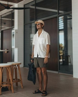 Men's Looks & Outfits: What To Wear In a Relaxed Way: This combo of a white short sleeve shirt and charcoal chinos is very easy to throw together and so comfortable to work as well! Go ahead and complement your ensemble with black leather sandals for an easy-going vibe.
