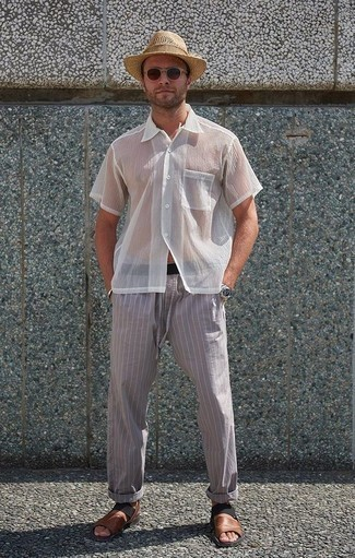 How to Wear a Tan Straw Hat For Men: Team a white mesh short sleeve shirt with a tan straw hat for a bold casual outfit that's easy to throw together. Add a pair of brown leather sandals to the equation to make a classic look feel suddenly edgier.