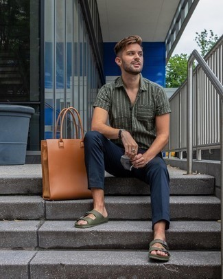 Sandals Outfits For Men: An olive vertical striped short sleeve shirt and navy chinos? It's easily a wearable ensemble that any man could wear on a day-to-day basis. Our favorite of an endless number of ways to finish this look is with sandals.