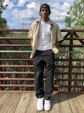 Black Cargo Pants Outfits: A beige short sleeve shirt and black cargo pants paired together are a match made in heaven for those dressers who appreciate casual looks. Add a pair of white leather low top sneakers to this outfit and ta-da: the look is complete.