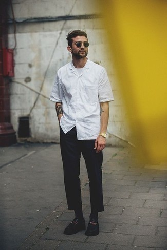 How to Wear Navy Chinos: Team a white vertical striped short sleeve shirt with navy chinos for an off-duty and fashionable ensemble. A pair of black leather loafers effortlesslly amps up the wow factor of any ensemble.