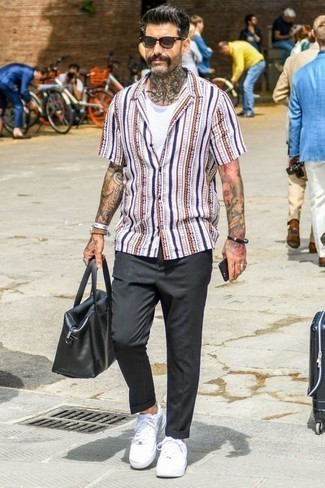 Black Leather Bracelet Outfits For Men After 40: This combo of a white vertical striped short sleeve shirt and a black leather bracelet is super stylish and provides instant off-duty cool. Put a dressier spin on your ensemble by finishing with white canvas low top sneakers. Ideal if you're looking for some seriously inspiring casual style for men in their forties.