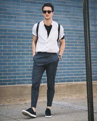 How to Wear a Black Crew-neck T-shirt For Men: Choose a black crew-neck t-shirt and navy chinos to create a casually cool outfit. If you're on the fence about how to round off, introduce a pair of black canvas low top sneakers to your look.