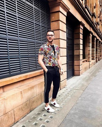 500+ Summer Outfits For Men: This on-trend outfit is super simple: a white floral short sleeve shirt and black chinos. Look at how great this look pairs with a pair of white print leather low top sneakers. This combo isn't a hard one to create and it's summer-appropriate, which is most important when it's super hot outside.