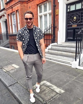 500+ Summer Outfits For Men: This casual pairing of a charcoal print short sleeve shirt and grey chinos couldn't possibly come across other than incredibly sharp. White print leather low top sneakers round off this look quite nicely. Is there a nicer option for an extremely hot warm weather day?