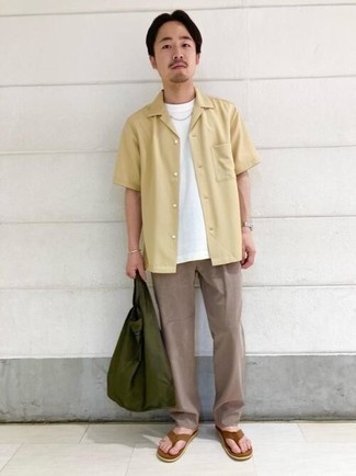 Flip Flops Outfits For Men: For effortless style without the need to sacrifice on comfort, we love this combo of a beige short sleeve shirt and khaki chinos. You could perhaps get a bit experimental on the shoe front and play down your outfit by finishing off with a pair of flip flops.