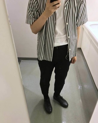 Black Leather Low Top Sneakers Outfits For Men: A resounding yes to this off-duty combination of a white and green vertical striped short sleeve shirt and black chinos! A pair of black leather low top sneakers is a tested footwear option that's also full of personality.