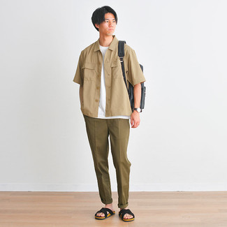 Charcoal Canvas Backpack Outfits For Men: A tan short sleeve shirt and a charcoal canvas backpack paired together are the perfect look for gents who appreciate laid-back and cool getups. When it comes to shoes, go for something on the relaxed end of the spectrum by wearing black suede sandals.