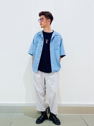 Navy Crew-neck T-shirt Outfits For Men: If you're a fan of laid-back getups, why not take this combo of a navy crew-neck t-shirt and white chinos for a spin? You can get a little creative with shoes and polish off this ensemble by slipping into a pair of navy leather casual boots.